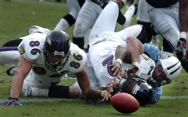 Ravens quarterback Anthony Wright loses the football as he is sacked by the Titans' Kyle Vanden Bosch.