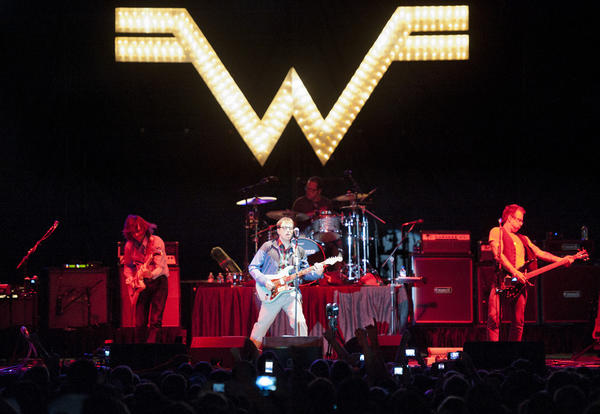 "Weezer plays one of its hits, ""Hash Pipe,"" to an excited crowd Saturday night in Baltimore. Attendees held up their cell phones to take pictures."