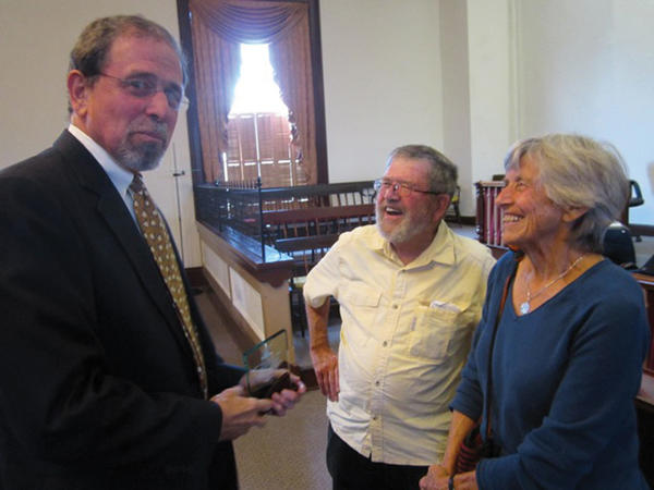 David H. Sanders, chief judge of the 23 Circuit, is congratulated by friends Ernest and Joan Johnston Friday after he was named West Virginia Judge of the Year by the West Virginia Association for Justice at a ceremony in Sanders chambers in Charles Town.