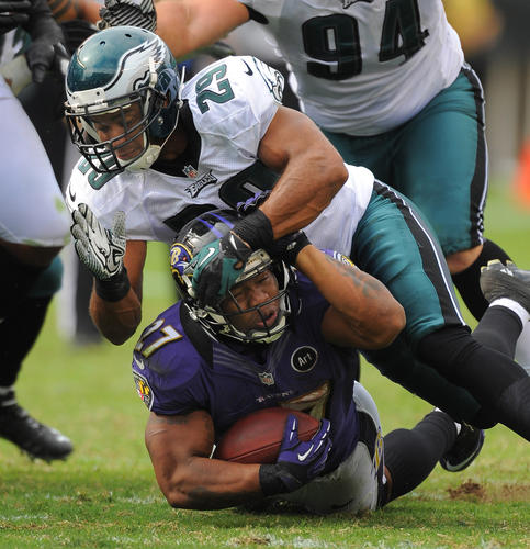 Ray Rice is brought down after a 2-yard gain by the Eagles' Nate Allen.