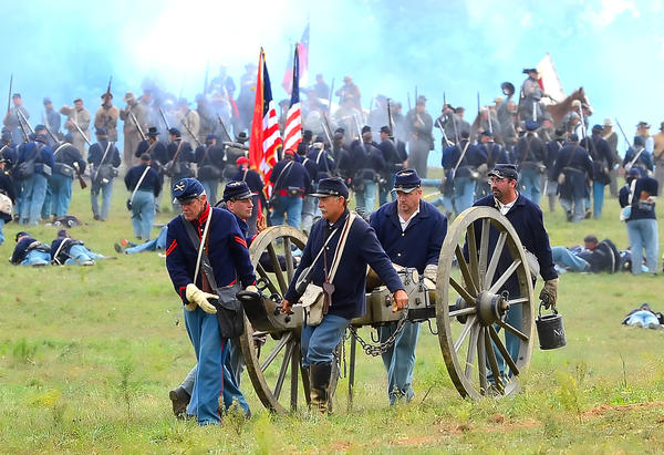 Union army re-enactors move before retreating back over Burnside Bridge Sunday afternoon at Antietam National Battlefield.