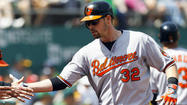 Orioles hold on to beat A's, 9-5, for their 82nd win