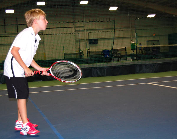 "Logan Feeney, 10, of Shippensburg, Pa., plays during Sunday's ""USTA Free Tennis Play Day"" at The Tennis Club in Zullinger, Pa."