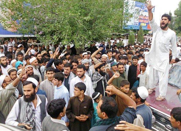 Afghan protesters shout slogans during an anti-NATO protest in the city of Mehtar Lam in Laghman province after eight women were killed in a NATO airstrike.