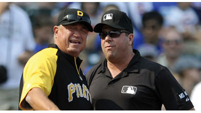Pittsburgh Pirates manager Clint Hurdle, left, argues with third base umpire Sam Holbrook after Holbrook called Neil Walker out at third base on a Andrew McCutchen single in the fourth inning of a baseball game against the Chicago Cubs on Sunday.