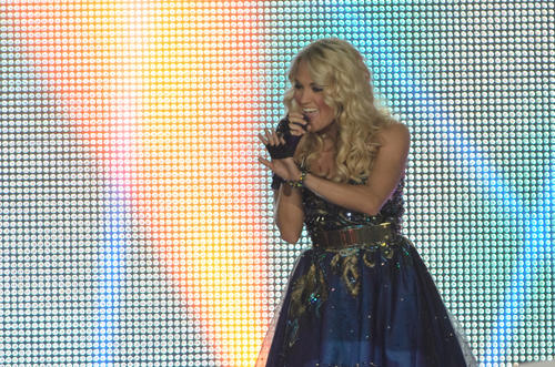"Carrie Underwood waves to fans in the audience at the Webster Bank Arena for her ""Blown Away"" tour Saturday night."