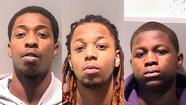 Three West Pullman men remained in custody Sunday after one allegedly shot at police while attempting to escape arrest.