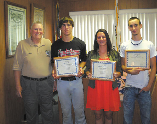From left, FOP Thomas Pangborn Lodge 88 President Dennis Mummert stands with Ryan Butts, Kaitlin Ridenour and Jeffery Moats, the 2012-13 recipients of the lodge's criminal justice scholarships.