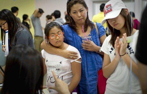 Irene Jeong, 10, left, of Los Angeles, her mother Susie and her friend Sarah Bong, 14, talk with a recruiter at the 2012 College Fair held on the campus of Bethel Korean Church in Irvine.