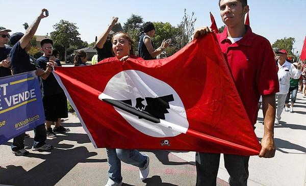 Members of the United Farm Workers union join forces with warehouse workers in a march Sunday in East Los Angeles.