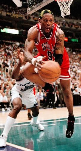 Chicago Bulls Dennis Rodman lunges for a rebound during the second quarter as the Utah Jazz host the Chicago Bulls during game six of the NBA finals.