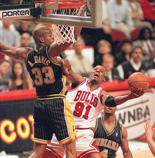 Chicago Bulls Dennis Rodman tries to keep the ball away from Pacers Antonio Davis. The Chicago Bulls met the Indiana Pacers in the 1998 Eastern Conference Finals.