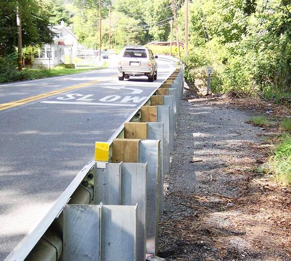 A PennDOT contractor installed this new section of guide rail on Route 611 in Williams Township recently, eliminating the narrow pull-off spot used by a nearby resident for more than 25 years.