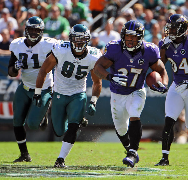 Ravens' Ray Rice, (No. 27), right, runs for 43 yards as he is chased by eagles Fletcher Cox, from left, and Mychal Kendricks (No. 95) in the second quarter. Baltimore Ravens is defeated by Philadelphia Eagles by score of 24 to 23.