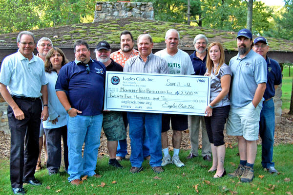 The Eagles Club Inc. of Waynesboro, Pa., donated $2,500 to Battle of Monterey Pass battlefield preservation efforts. Shown, from left, are Steve Patterson, Charles Strausbaugh, Elaine Gladhill, Dirk Rakentine, Todd Clopper, Gary Muller, Lee Royer, Ken Brown, John Gorman, Alicia Miller, John Miller and Mike Christopher.