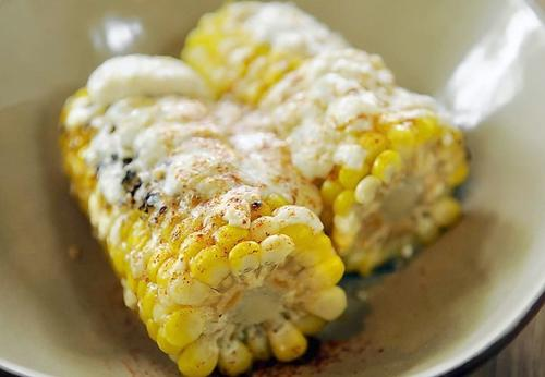 Grilled corn with lime, cayenne, cotija cheese  at Bartaco.