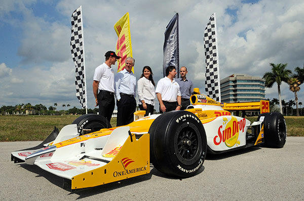 Ryan Hunter-Reay, Stephen Fenwick, Christine Nashick, Michael Andretti and Brian Krejsa unveil the new DHL branded IndyCar.