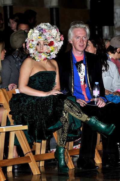 Lady Gaga scopes out the fashions from the front row of the Philip Treacy show at London Fashion Week.