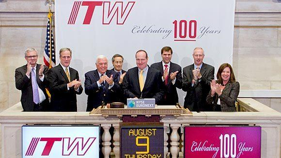 ITW executives ring the closing bell at the New York Stock Exchange in honor of the company's 100th anniversary in 2012.