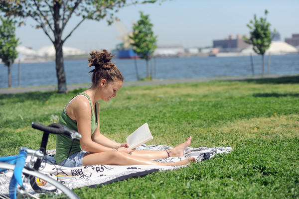 Dyana DeSantis of Baltimore reads a book at Fort McHenry on an unusually hot day in April.