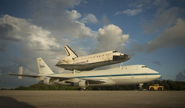 Space shuttle Endeavour is seen atop NASA's Shuttle Carrier Aircraft, or SCA, at the Shuttle Landing Facility at NASA's Kennedy Space Center in Cape Canaveral,, Florida, September 17, 2012. The SCA, a modified 747 jetliner, will fly Endeavour to Los Angeles where it will be placed on public display.