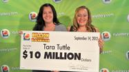 Cary Tullos, left, with her domestic partner, winner Tara Tuttle.