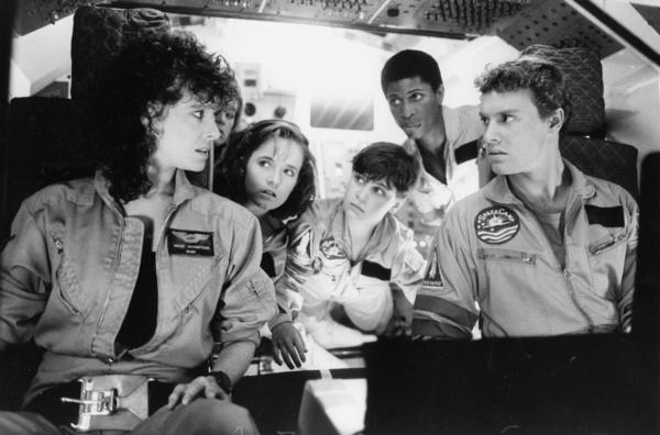 <b>Launch date:</b> 1986 <br><br> <b>Pilot:</b> Kathryn Fairly (played by Lea Thompson) flies the shuttle after teacher and astronaut Andie Bergstrom (Kate Capshaw) is injured. <br><br> <b>Shuttle mission:</b> Four teenagers, a 12-year-old boy and their teacher are at SpaceCamp, touring the shuttle Atlantis when it is accidentally launched into space. But the shuttle isn't flight-ready, lacking oxygen and voice communications with NASA, and the young astronauts embark on a mission to retrieve enough stored oxygen from a space station to make it home. <br><br> <b>Outcome:</b> The kids learn to trust themselves and each other, working as a team to land safely on Earth. The mission is a success, but the movie was critically panned.