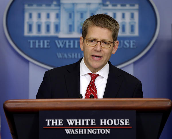 "White House Press Secretary Jay Carney speaks during his daily news briefing at the White House in Washington. Carney says the attacks in Egypt, Libya and elsewhere were a ""response not to United States policy, and not to, obviously, the administration, not to the American people,"" but were rather a ""response to a video, a film we have judged to be reprehensible and disgusting."""