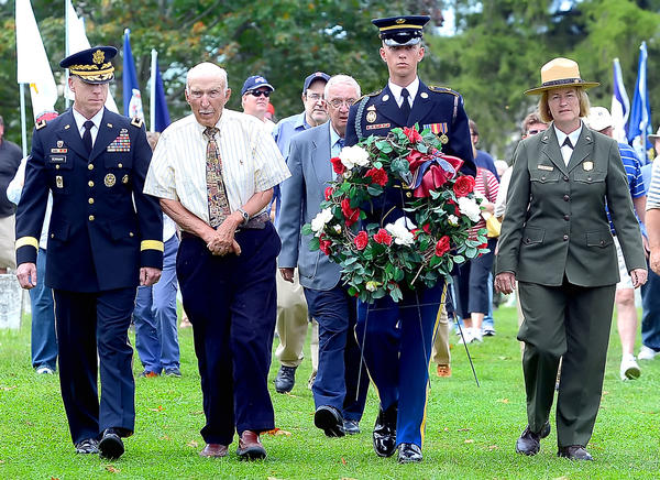 Officials gathered at a remembrance ceremony to place a wreath Monday afternoon at Antietam National Cemetery. From left, U.S. Army Maj. Gen. Mark S. Bowman, Edwin Bearss, National Park Service Historian Emeritus, SPC Derek Holway with the U.S. Army 3rd Infantry RegimentOld Guard, and Antietan National Battlefield Superintendent Susan Trail.