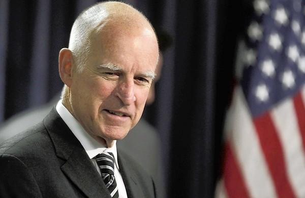 Gov. Jerry Brown signed a revised ban on protests at funerals that decreased the buffer from 1,000 feet to 300 feet.