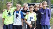 NEWBERRY -- Logan Hensley finished first and Mark Smith was second, leading the Petoskey High School boys cross country team to a first-place finish Saturday in the Newberry Kiwanis Invitational.