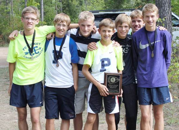 Members of the Petoskey High School boys cross country team display their first-place plaque after winning the Newberry Invitational on Saturday. Team members are (from left) Logan Hensley, Max Meyerson, Tom VanSlembrouck, Jacob Kromm, Mark Smith, Christopher Taylor and Ross Hooley.