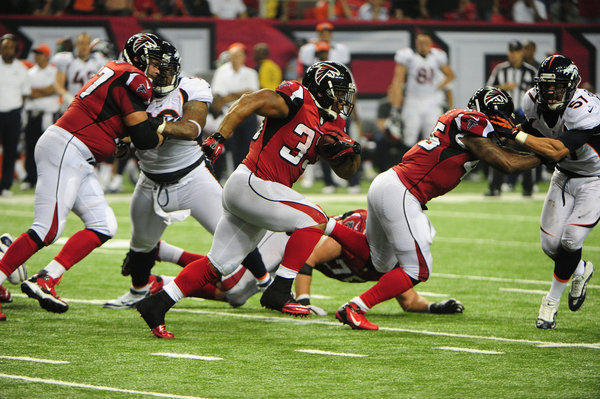 Michael Turner of the Atlanta Falcons carries the ball Monday night against the Denver Broncos.