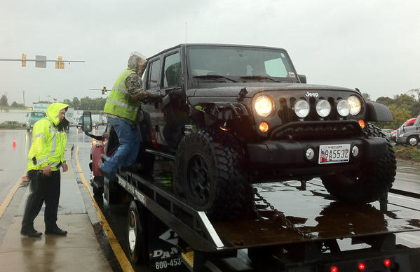 A Jeep is prepared for towing from the scene of an accident Tuesday morning at the intersection of Halfway Boulevard and Hopewell Road. The driver was taken to Meritus Medical Center.