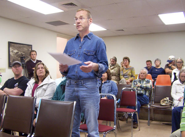 Several citizens stood up and expressed their frustration with the noises and smells coming from Kirtland Products located in Boyne City's industrial park at a public hearing at city hall Monday. Others offered support for the progress Kirtland has made in reducing noise and asked for more time from the planning commission for them to ameliorate existing problems. Pictured standing is Ian Mitchell who said he would move away from Boyne City if Kirtland is allowed to continue operating.