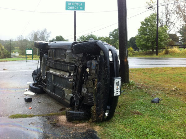 A vehicle came to rest on its side after sliding off Mapleville Road and crashing into a pole Tuesday morning. No one was injured, police said.