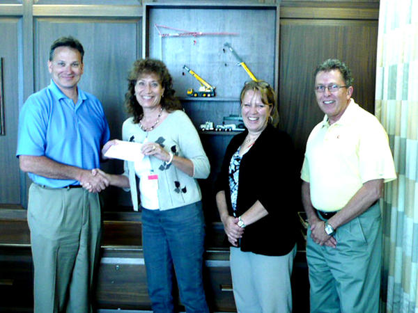 Pictured from left are Larry Weyers, executive vice president of Manitowoc Cranes Americas; Pam Anderson, 2011 United Way campaign chairman; Amy Hicks, executive director of the Franklin County United Way; and Pat Cassner, vice president of operations for Manitowoc Cranes.