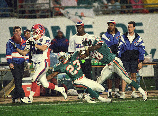 <b>12/04/1994</b><br></br> Miami Dolphins v. Buffalo Bills at Joe Robbie Stadium (now Land Shark Stadium). Buffalo's Don Beebe beats Miami's Troy Vincent (23) and Gene Atkins (28) on this third quarter pass reception for a touchdown.