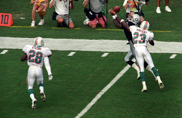 <b>10/16/1994</b><br</br> Miami Dolphins v Los Angeles Raiders at Joe Robbie Stadium (now Sun Life Stadium)  Miami's corner back Troy Vincent (23) breaks up a pass to Raiders wide receiver Tim Brown in the third quarter