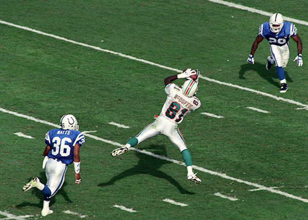 <b>11/06/1994</b><br></br> Miami Dolphins v Indianapolis Colts at Joe Robbie Stadium (now Sun Life Stadium) Miami's wide receiver O.J. McDuffie (81) catches a Marino pass and runs it in for a touchdown in the fourth quarter, bringing the Colts lead to only 2 points.