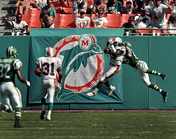 <b>09/18/1994</b><br></br> Miami Dolphins v New York Jets at Joe Robbie Stadium (now Sun Life Stadium) Dolphins safety Michael Stewart intercepts a pass intended for New York Jets wide receiver Stevie Anderson at the end of the fourth quarter. Dolphins won the game 28 - 14.