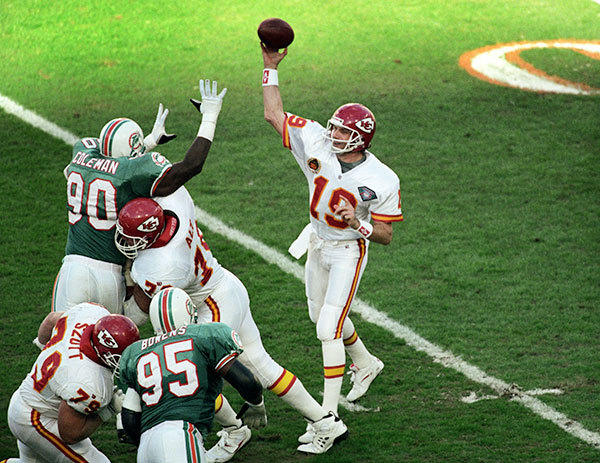 <b>12/31/1994</b><br></br> Miami Dolphins v Kansas City Chiefs Wildcard Playoff Game at Joe Robbie Stadium (now Sun Life Stadium) Chiefs quarterback Joe Montana finds himself under Dolphin pressure with Marco Coleman (90) in his face and Tim Bowens (95) not far away.