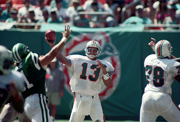 <b>09/18/1994</b><br></br> Miami Dolphins v New York Jets at Joe Robbie Stadium (now Sun Life Stadium) Miami Dolphins quarterback Dan Marino (13) passes over Jets defensive tackle Paul Frase (91). Dolphins offensive lineman Richmond Webb (78) is seen on right.