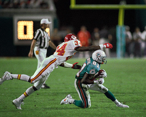 <b>12/12/1994</b><br></br> Miami Dolphins v Kansas City Chiefs at Joe Robbie Stadium (now Sun Life Stadium) Miami's O.J. McDuffie's third quarter pass reception survives a shot at his head by the Chief's Dale Carter (34).