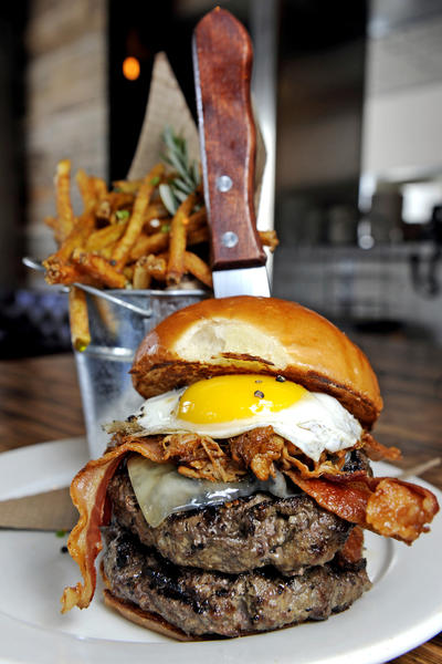 The Roosevelt burger at Kettle Hill includes two 9 ounce angus patties, barbeque pork, bacon, a fried egg and jack cheese.