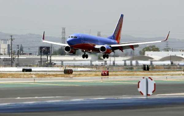 A Southwest Airlines plane lands at the Bob Hope Airport on Thursday, July 19, 2012.