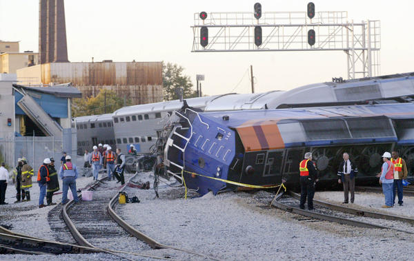 Authorities inspect the wreckage of a Metra train after Sunday's derailment on the Rock Island line at 47th Street in Chicago in 2003.