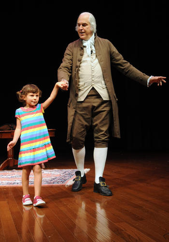 Alyssa Howe, 5, of Forks Township is taught a minuet by Dean Malissa the official historical portrayer of George Washington for Mount Vernon. He talked about Washington's life and time in character in the Lipkin Theatre at Northampton Community College Tuesday morning. NCC is hosting a years worth of films, discussions, portrayals and presentations around the theme of 'The American Presidency'. It's supported by the Challenge Grant from the National Endowment for the Humanities.
