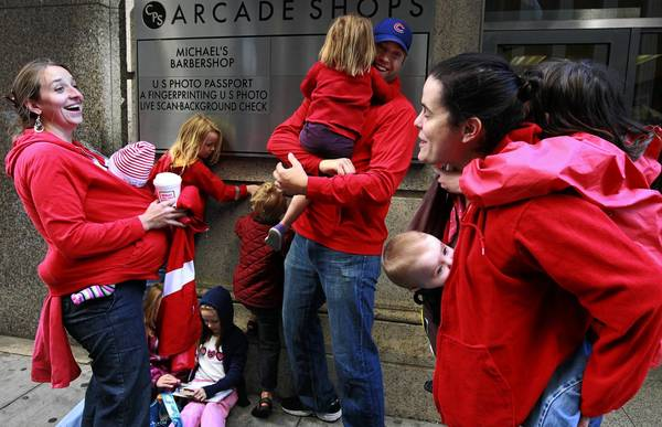 Parents of students at CPS, Megan Trintea, left, her husband and CPS teacher Scott Trintea and Amy Catania join students, parents and striking CPS teachers at CPS Headquarters where they delivered 1,000 postcards to CPS CEO Jean-Claude Brizard to demand a contract.