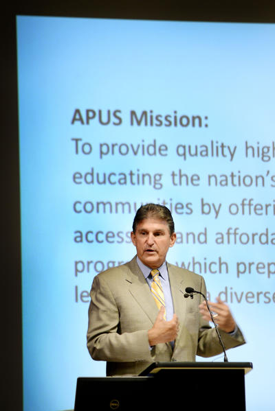 U.S. Sen. Joe Manchin, D-W.Va., speaks Tuesday at a ribbon cutting at the new finance center for American Public University System in Charles Town, W.Va.